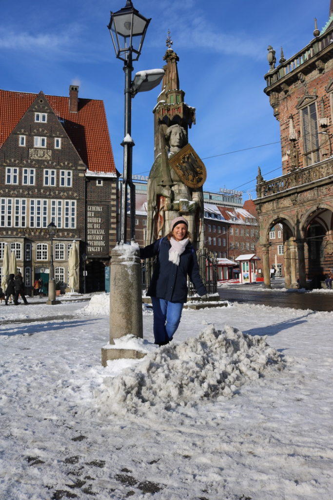 Roland statue and me in snow_Photo Copyright Sonja Irani_RevisitGermany.com
