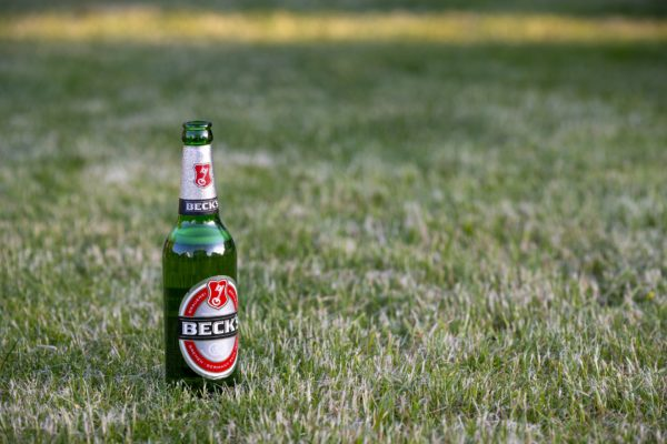 Becks beer bottle with the key showing to the right. Photo by Pixabay | gerlex